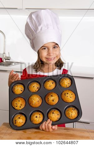 Proud Female Child Presenting Her Self Made Muffin Cakes Learning Baking Wearing Red Apron And Cook