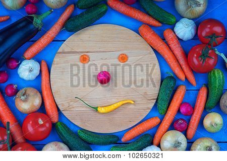 Smiley face made from vegetables among colorful vegetables