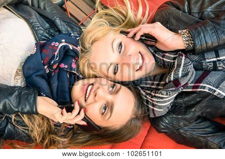 Best Friends Enjoying Time Together Outdoors With Smartphone - Girlfriends and New Technologies