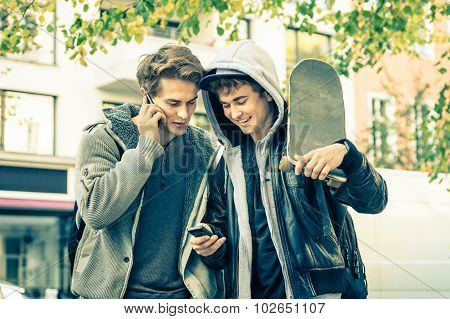 Young Hipster Brothers Having Fun With Smartphone - Best Friends Sharing Free Time With New Trends
