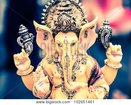 Yellow Ganesh Elephant Hindu God Statue Closeup Focused On Face