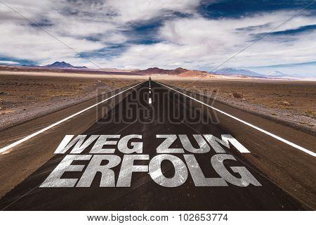 Road to Success (in German) written on desert road