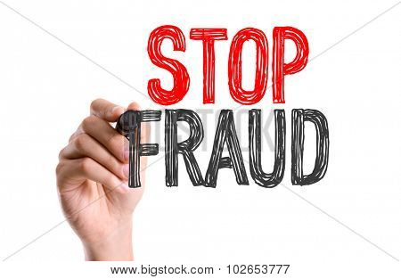 Hand with marker writing: Stop Fraud