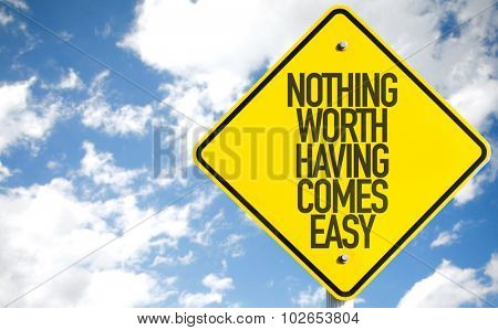 Nothing Worth Having Comes Easy sign with sky background