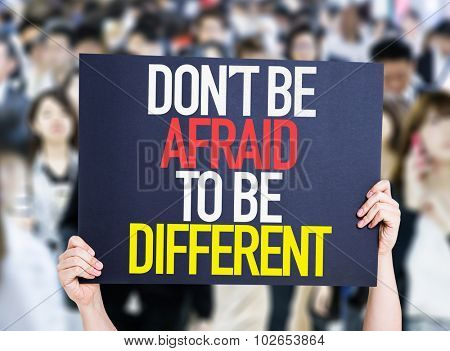 Don't Be Afraid To Be Different placard oh crowd of people