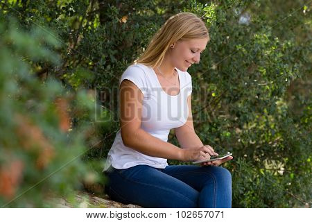 blond young women using internet outdoor