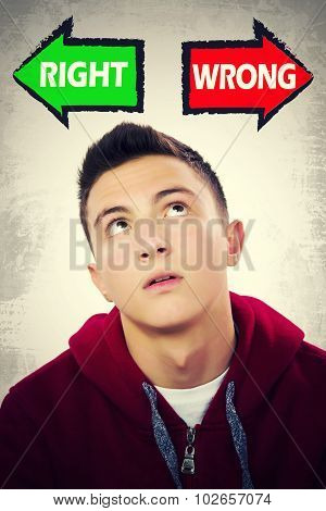 Teenage Boy Facing Choice Between Right And Wrong