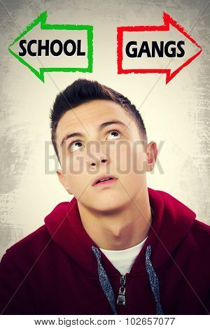 Teenage Boy Facing Choice Between School And Gangs
