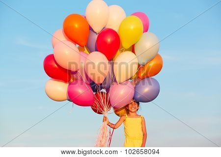 Happy Little Girl Child Kid With Balloons  On Sky Background