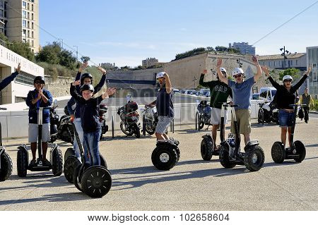 Tourist Group Moving Segway