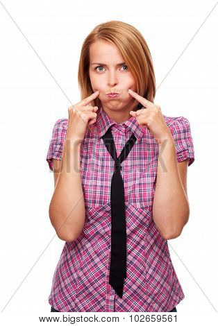 Young casual girl inflates her cheeks in studio