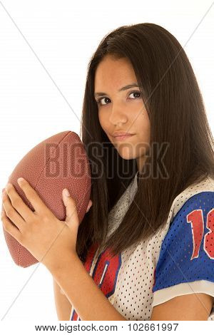 Beautiful Hispanic Teenage Girl Holding An American Football