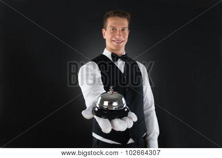 Waiter Holding Service Bell