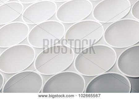 Large group of disposable plastic cups.