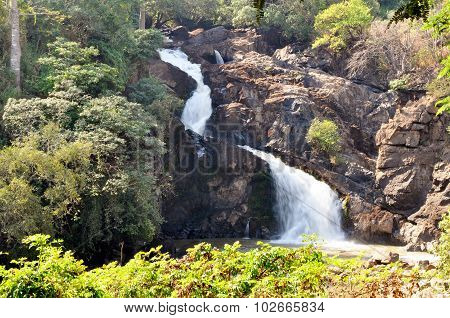 Beautiful Waterfall Cascading Down in a Tropical Surrounding