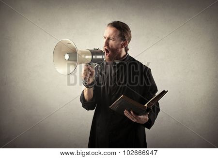Priest shouting into a megaphone