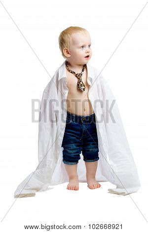 Little Boy In A Large Shirt And Tie