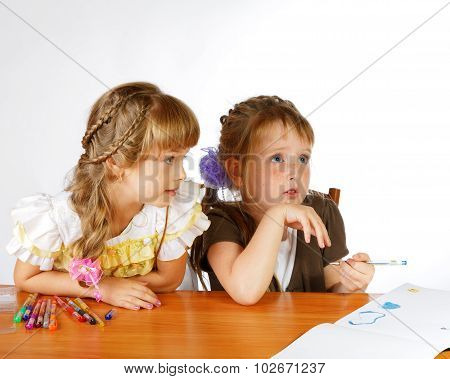 Two Girls Draw With Markers In Album