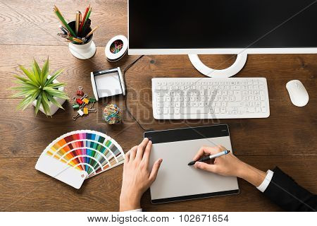 Male Designer Using Digital Graphic Tablet