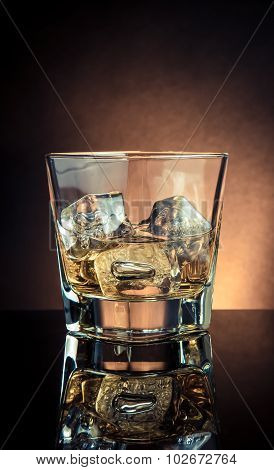 Glass Of Whiskey On Black Table With Reflection, Old Style Atmosphere