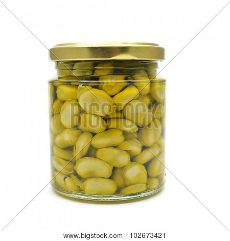 a glass jar with cooked broad beans on a white background