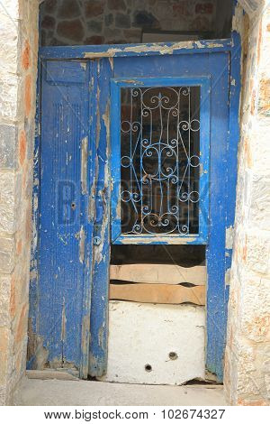 Door Of An Old Building In Malia.
