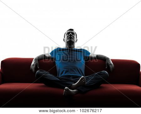 one caucasian man sofa couch relaxing in silhouette isolated on white background