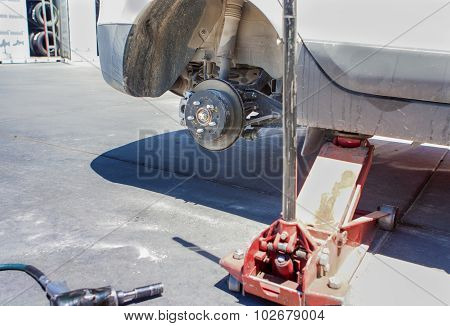Automotive Concept: Car Wheel Is Being Maintained On Professional Car Repair Station