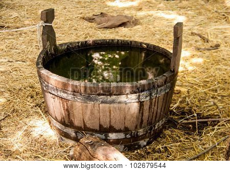 Antique Bucket With Water In The Courtyard Of A Castle
