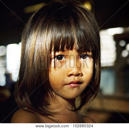 Little girl staring at the camera Facial Expression Concept