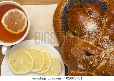 Challah With Raisins And A Bagel With Poppy