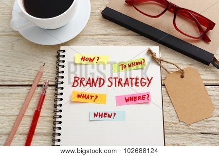 Brand Marketing Strategy Concept With Notebook And Brand Tag