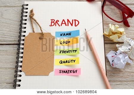 Brand Marketing Concept With Brand Tag On Notebook