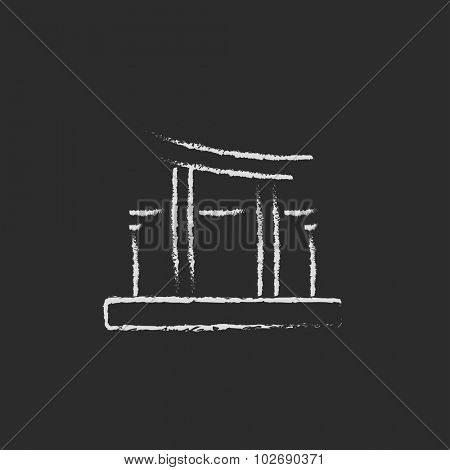 Torii gate hand drawn in chalk on a blackboard vector white icon isolated on a black background.