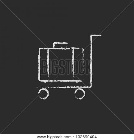 Luggage on a trolley hand drawn in chalk on a blackboard vector white icon isolated on a black background.