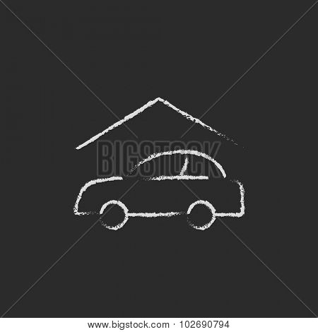 Car garage hand drawn in chalk on a blackboard vector white icon isolated on a black background.