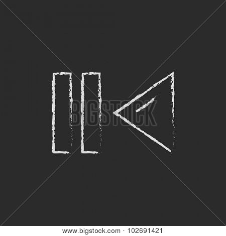 Pause and playback button hand drawn in chalk on a blackboard vector white icon isolated on a black background.