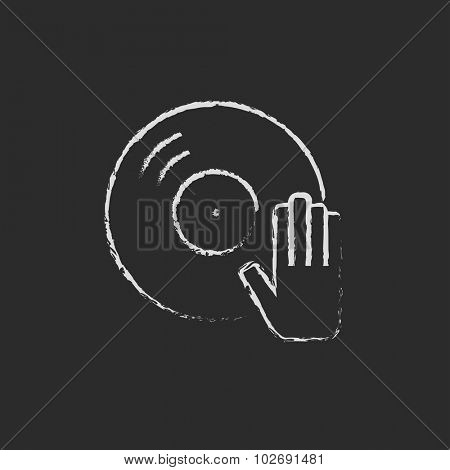 Dj hand with disc hand drawn in chalk on a blackboard vector white icon isolated on a black background.