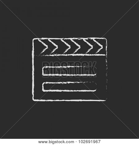 Clapboard hand drawn in chalk on a blackboard vector white icon isolated on a black background.