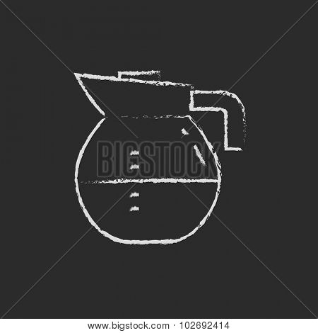 Carafe hand drawn in chalk on a blackboard vector white icon isolated on a black background.