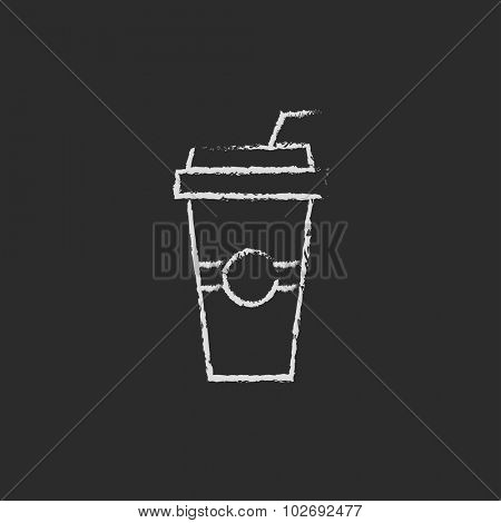 Disposable cup with drinking straw hand drawn in chalk on a blackboard vector white icon isolated on a black background.