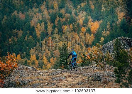 young man on mountain bike