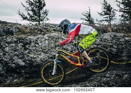 mountainbiker slides down the mountainside