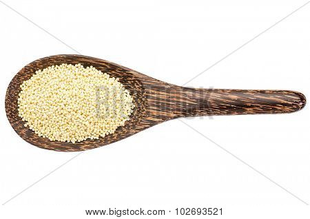 gluten free millet grain on a wooden spoon isolated on white