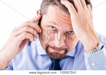 Stressed Businessman Making A Phone Call.