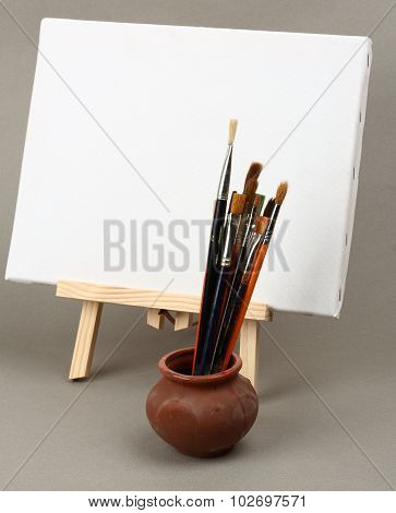 Brushes And Easel