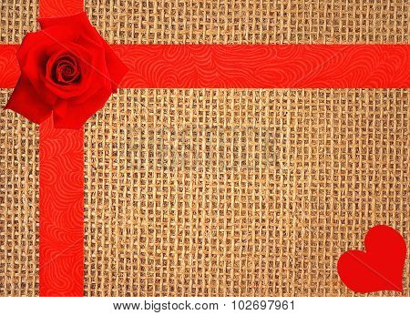 Red Rose And Heart On Linen Texture Background With Red Ribbon