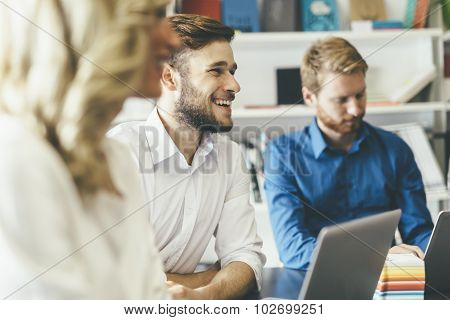 Cheerful Coworkers In Office