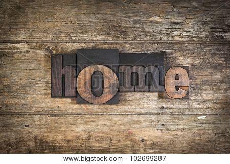 home, set with vintage letterpress printing blocks on wooden background