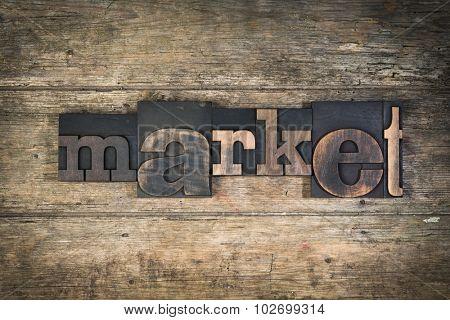 Market, set with vintage letterpress printing blocks on wooden background